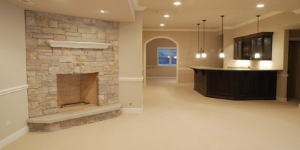 basement finishing with fireplace and bar
